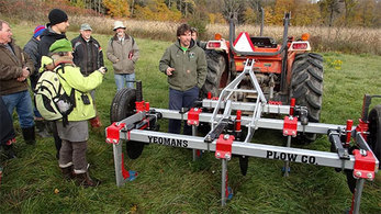 Darren Doherty with workshop participants and tractor with Yeomans Plow Co. plow.